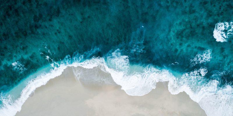 ocean waves crashing into the beach